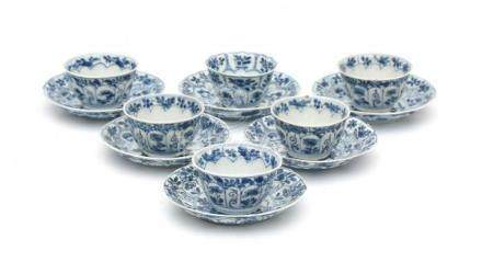 A set of six Chinese blue and white cup and saucers, decorated with bird amidst blossoming