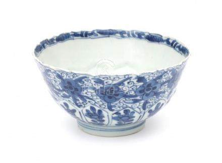 A Chinese blue and white bowl, decorated with flowers. Marked with a lozenge, Kangxi period (1662-
