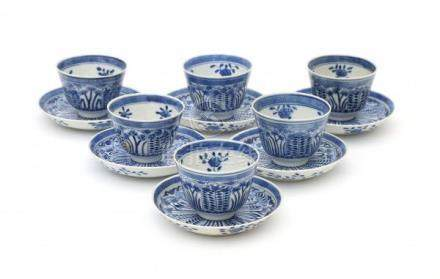 A set of six Chinese blue and white cup and saucers, decorated with flowers in petal shaped