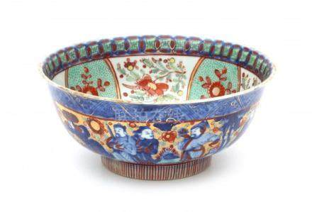 A Chinese 'clobbered' bowl, decorated with immortals and the inside with a dragon. 18th