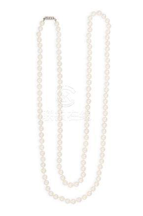 A CULTURED PEARL NECKLACE WITH DIAMOND CLASPThe single row of cultured pearls o