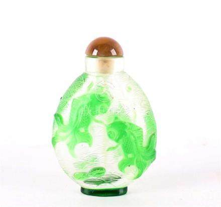 A clear glass snuff bottle with a green goldfish overlay, Ch