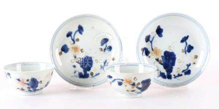 Two Imari Chinese porcelain cups and matching saucers.