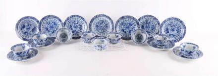 Various contoured porcelain cups on stand ring and saucers,