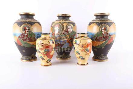 A series of three baluster-shaped Satsuma vases, Japan, Meij