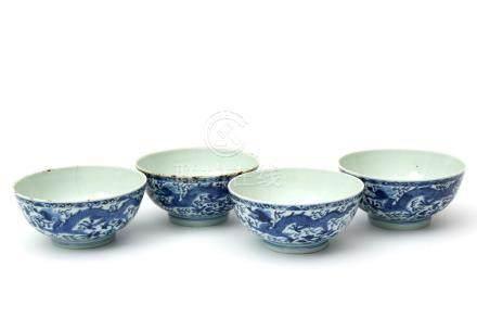Four blue & white dragon bowls