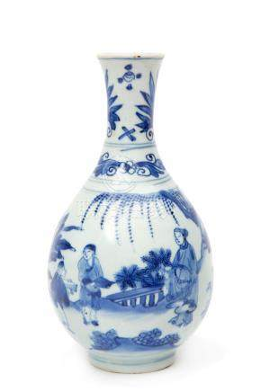 A blue & white vase with figures in a garden