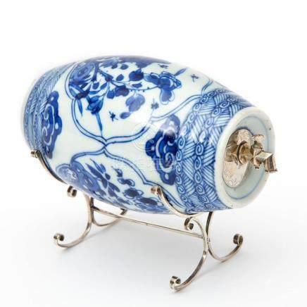 A blue & white liquor barrel on silver stand