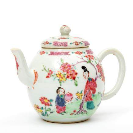 A fencai teapot decorated with figures in a garden