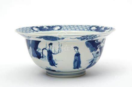 "A blue & white ""klapmuts"" bowl of figures in a garden"