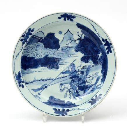 A large porcelain blue & white plate with hunting scene
