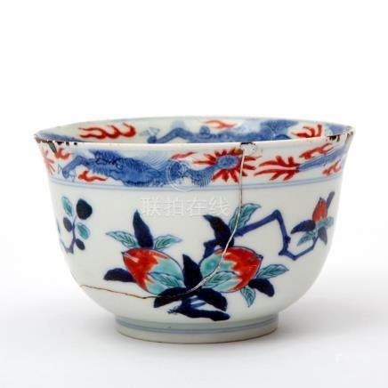 A doucai bowl decorated with peach and pomegranate and a dra