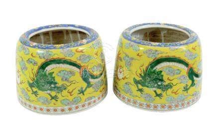A pair of Chinese famille jaune bowls, cushioned