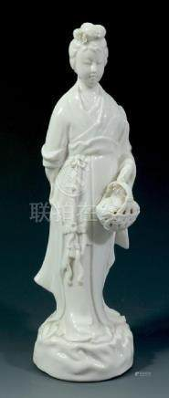 A Chinese Blanc de Chine figure of Guanyin, modelled