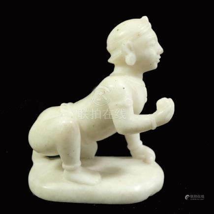An Indian carved white marble figure, modelled