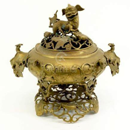 A Chinese bronze censor, reticulated and moulded in