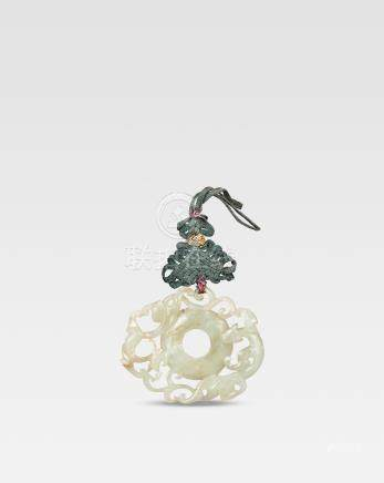 A pale green jade reticulated 'chilong' disc, bi Ming Dynasty