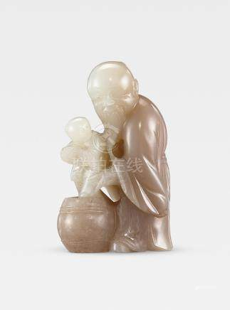 A pale green and greyish-white jade 'sage and boy' group  18th century  (3)