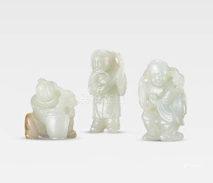 A  group of pale green jade figures of 'Liu Hai' and two boys Qing Dynasty  (6)