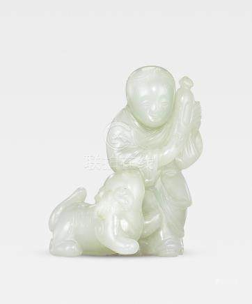 A very pale green jade 'boy and lion' group  Ming Dynasty