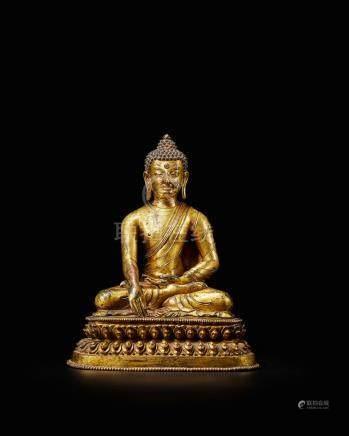 A fine gilt-bronze figure of Shakyamuni Buddha Nepal, 17th century
