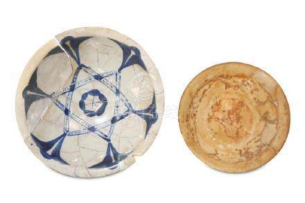 AN ABBASID BLUE AND WHITE POTTERY DISH AND AN IRANIAN