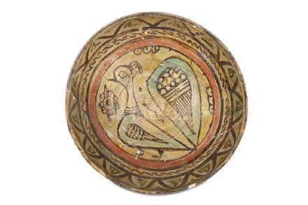 A NISHAPUR BUFFWARE POTTERY BOWL Iran, 10th century Of