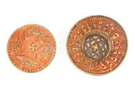 TWO SLIP-PAINTED POTTERY BOWLS WITH STIPPLED DECORATION