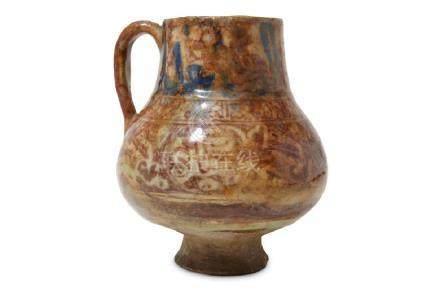 A RAQQA COPPER-LUSTRE POTTERY JUG Syria, 13th century