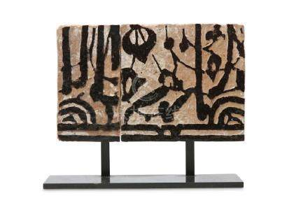 A FRAGMENT OF A MARINID TERRACOTTA TILE Morocco, 14th -