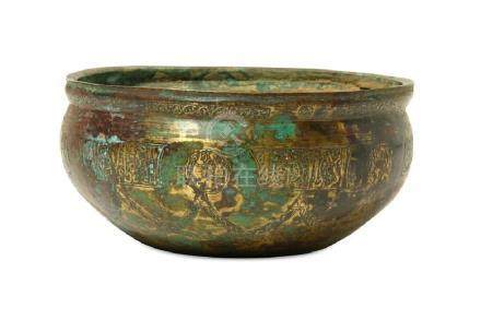 AN ENGRAVED BRASS BASIN WITH KUFIC INSCRIPTIONS Iran,