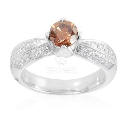 A 0.85 CARAT FANCY BROWN DIAMOND AND WHITE DIAMOND RING