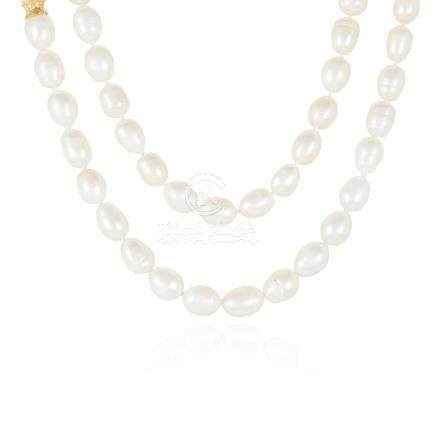 A PEARL WRAP AROUND CORD NECKLACE in yellow gold,