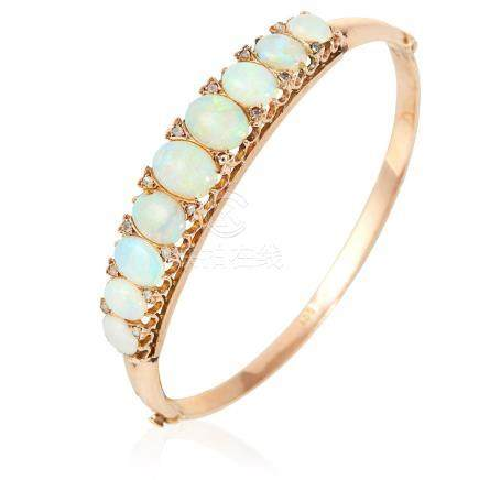 AN ANTIQUE OPAL AND DIAMOND BANGLE in yellow gold, set