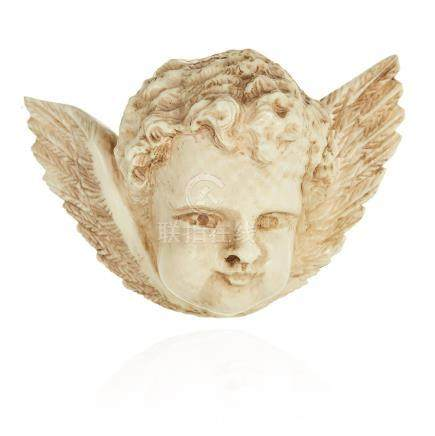 AN ANTIQUE CARVED IVORY CHERUB BROOCH, 19TH CENTURY