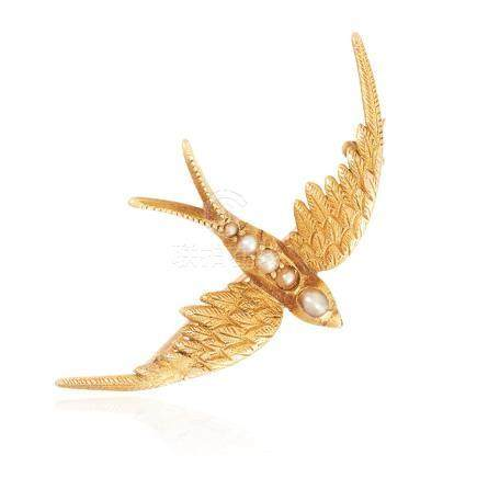 AN ANTIQUE PEARL SWALLOW BROOCH in high carat yellow