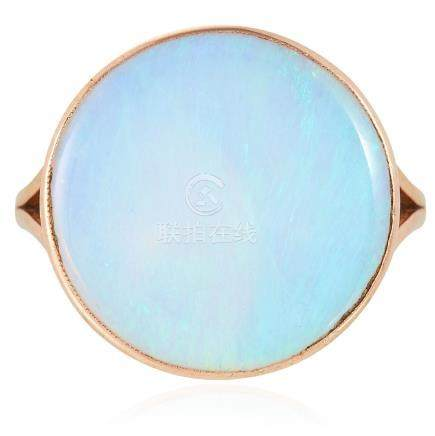 AN OPAL DRESS RING in yellow gold, set with a cabochon