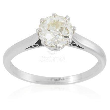 A SOLITAIRE DIAMOND RING in platinum, set with an old