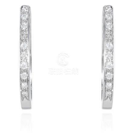 A PAIR OF DIAMOND HOOP EARRINGS in white gold or