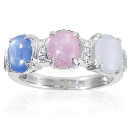 A STAR SAPPHIRE AND DIAMOND RING in 18ct white gold,