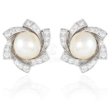 A PAIR OF PEARL AND DIAMOND EARRINGS in white gold or