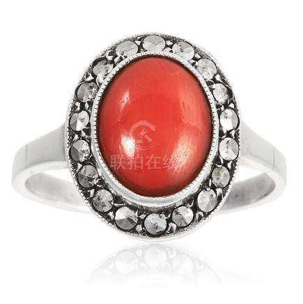 A PAIR OF CORAL AND MARCASITE RINGS in white metal,