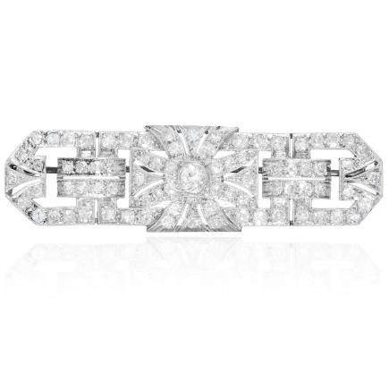 AN ART DECO DIAMOND BROOCH in platinum, the rectangular