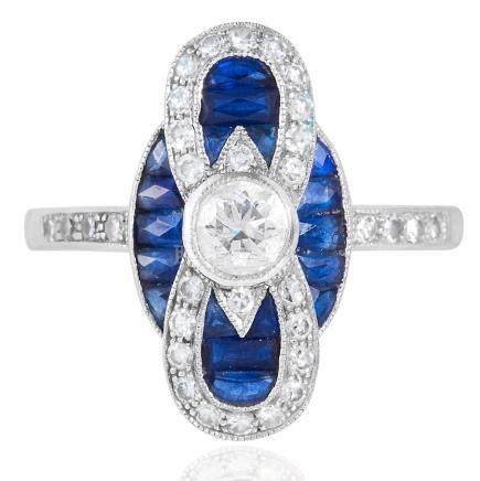 A SAPPHIRE AND DIAMOND DRESS RING in 18ct white gold,
