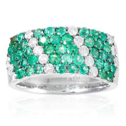 AN EMERALD AND DIAMOND DRESS RING in 18ct white gold,