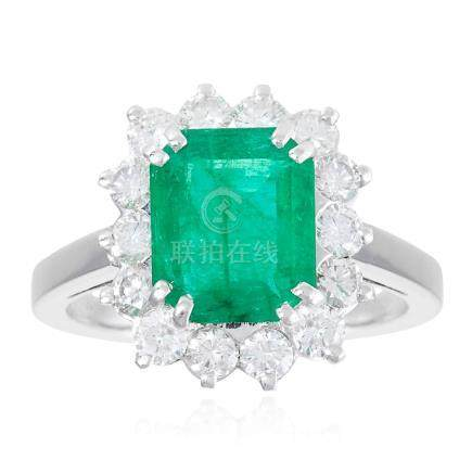 AN EMERALD AND DIAMOND CLUSTER RING in white gold or