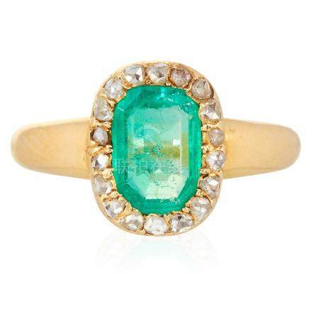 AN EMERALD AND DIAMOND CLUSTER RING in high carat