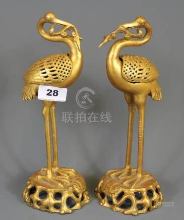 A pair of Chinese gilt bronze crane censers, H. 27cm.