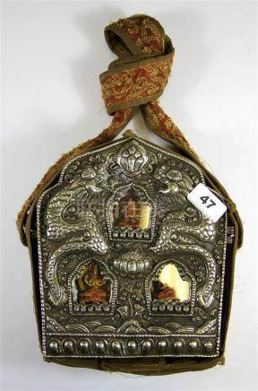A large Tibetan white metal and copper ga'u (portable shrine) in a silk carrying case, H. 23cm.