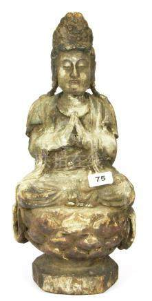 A Chinese carved wooden figure of the goddess Guanyin with remnants of ghesso and paint, H. 45cm.